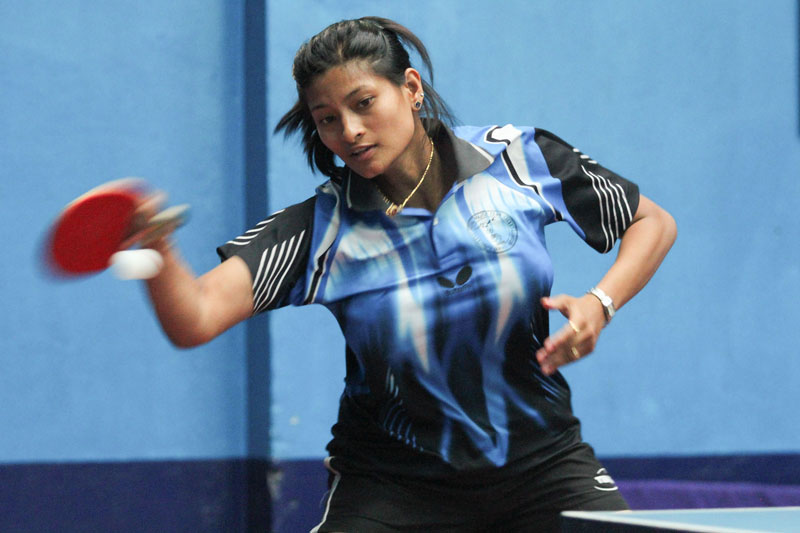 Nabita Shrestha of NPC returns to Anita Maharjan of Nepal APF during their quarter-final match of the Venus Cup National Open Table Tennis Tournament in Kathmandu on Monday. Photo: Udipt Singh Chhetry/THT