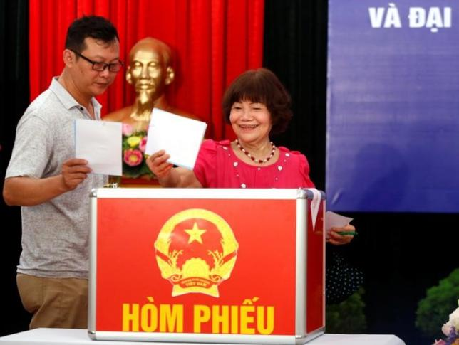 Voters cast their ballots for members of the 14th National Assembly and People's Councils at a polling station in Hanoi, Vietnam May 22, 2016. REUTERS/Kham