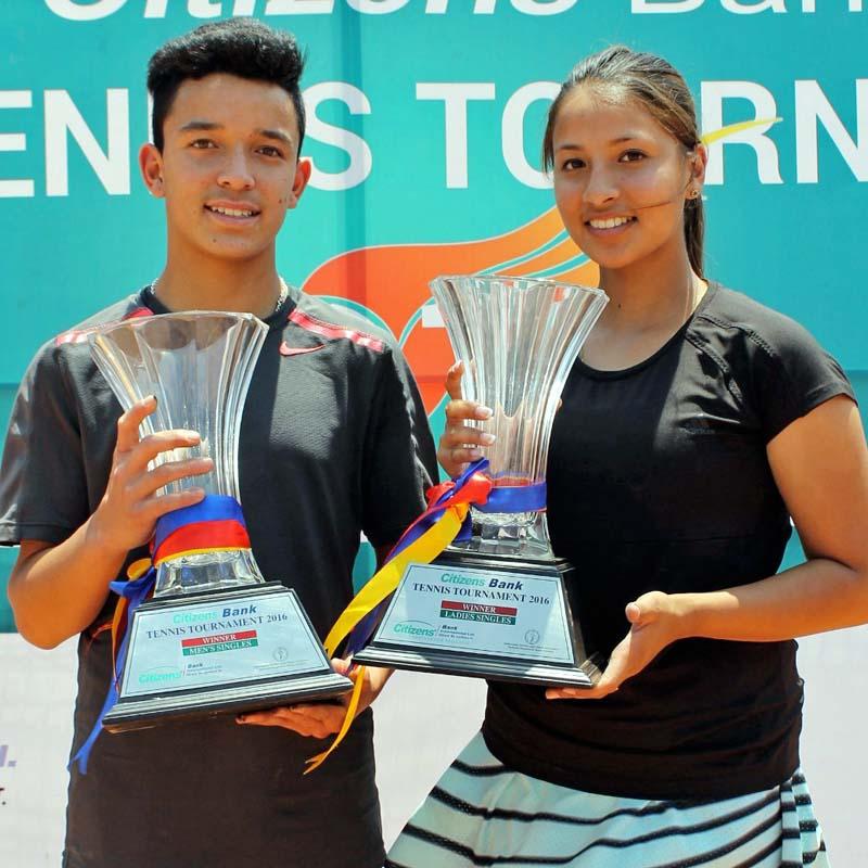 Samrakchyak Bhusan Bajracharya and Mayanka Rana hold the trophies after the fourth Citizens Bank Open Tennis Tournament in Kathmandu on Saturday, April 30, 2016. Photo: THT