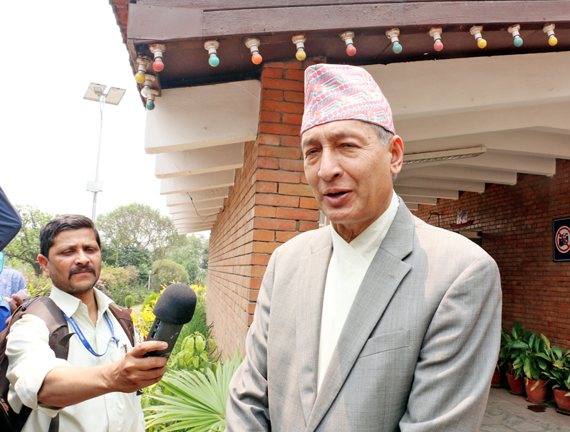 Vice-chairman of National Planning Commission Dr. Yuba Raj Khatiwada speaking briefly with journalists after attending a NPC meeting at the Prime Minister's residence in Baluwatar on Monday, May 2, 2016. Photo: RSS