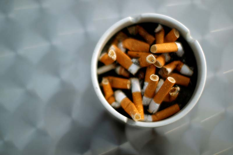 An ash tray with cigarette butts is pictured in Hinzenbach, in the Austrian province of Upper Austria, on February 5, 2012. Photo: Reuters