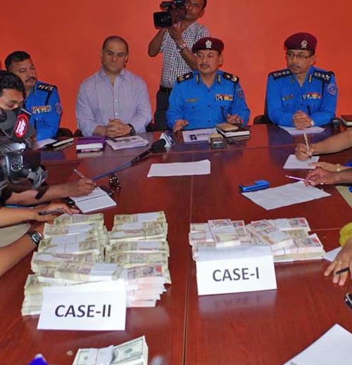 AIG Pratap Singh Thapa, the chief of Metropolitan Police Office, Ranipokhari, along with other official briefing the media about the haul of fake Indian rupees and USD. Photo: MPO