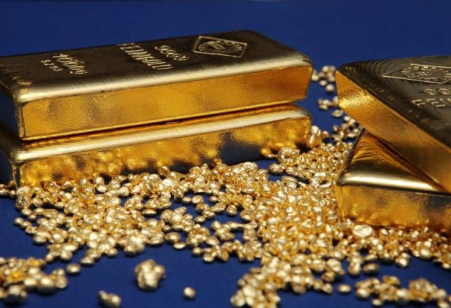 Gold bars and granules are pictured at the Austrian Gold and Silver Separating Plant 'Oegussa' in Vienna October 23, 2012. REUTERS/Heinz-Peter Bader