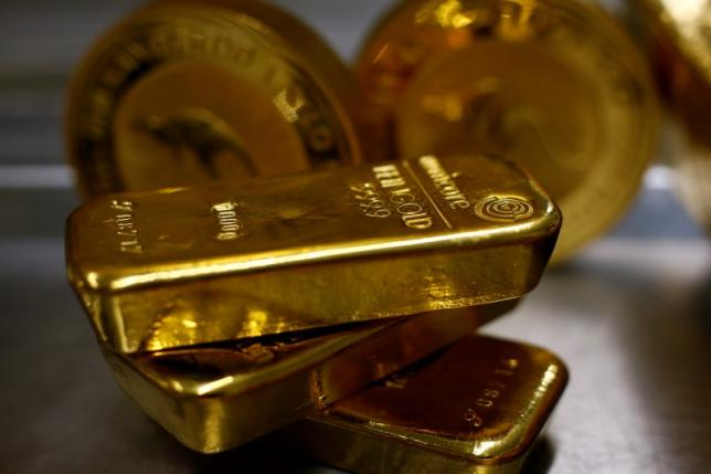 Gold bars are stacked in the safe deposit boxes room of the Pro Aurum gold house in Munich March 3, 2014. REUTERS/Michael Dalder