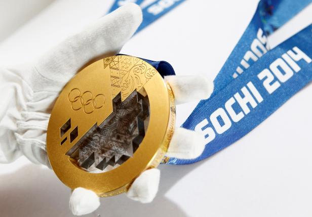 A gold medal manufactured for the 2014 Winter Olympic Games in Sochi, is seen on display at the Adamas jewellery factory in Moscow, June 28, 2013. REUTERS/Sergei Karpukhin/File Photo