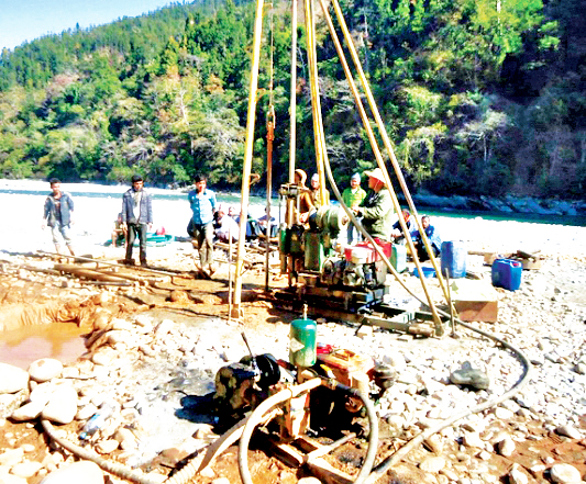 A Chinese team studying the possibility of finding a gold mine on the banks of the Bheri River, in Bherimalika Municipality, Jajarkot, on Wednesday, May 18, 2016. Photo: Dinesh Shrestha