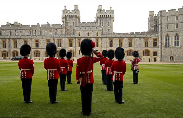 Guardsman stand in formation at Windsor Castle in Windsor, England, Britain April 22, 2016. REUTERS/Kevin Lamarque/Files
