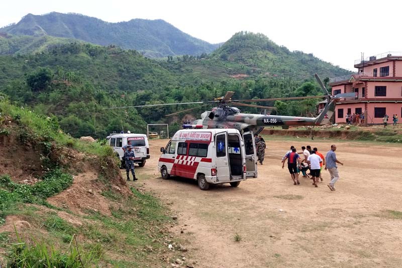 Injured APF personnel being transported to a Nepal Army helicopter from an ambulance, in order to airlift them to Kathmandu for further treatment, in Damauli, on Sunday, May 22, 2016. Photo: Madan Wagle/ THT