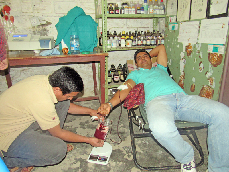 Gynaecologist Dr Rajan Neupane of Emergency Parturition Service donating blood at District Hospital, Bajura, on Monday, May 2, 2016. Photo: THT