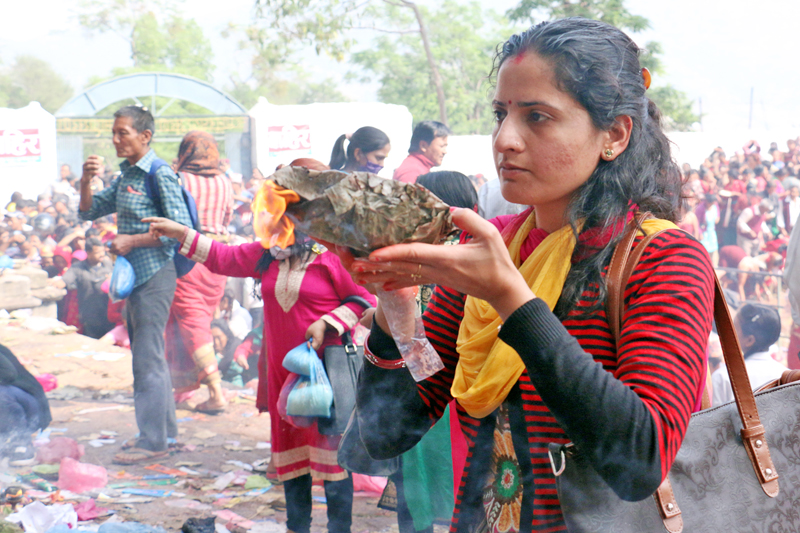 A devotee offers homage to her mother on the occasion of Mother's Day in Matatirtha of Kathmandu, on Friday, May 6, 2016. Photo: RSS