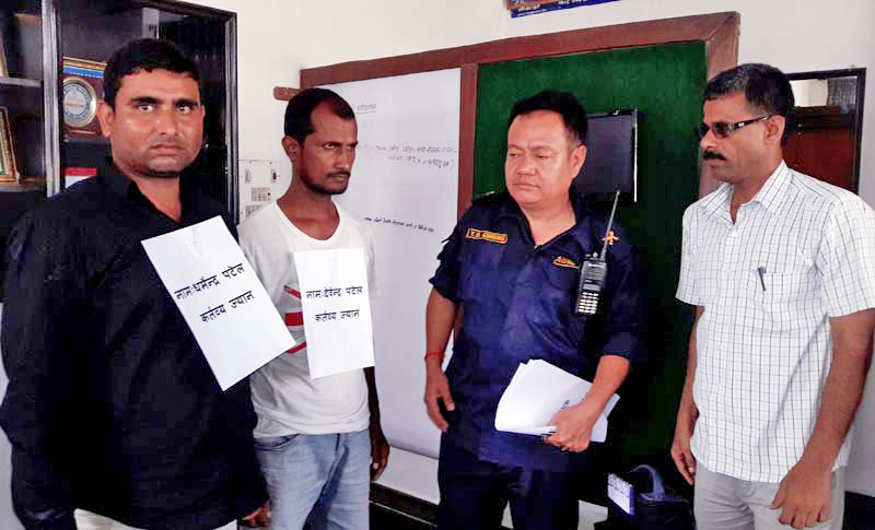 Police making public two murder suspects at Parsa District Office, on Wednesday, May 25, 2016. Photo: Ram Saaraf