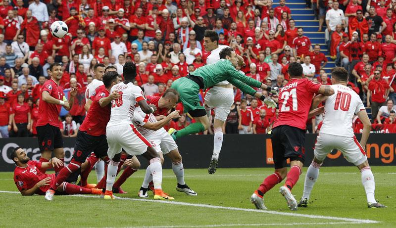 Switzerland's Fabian Schar scores their first goal against Albania.