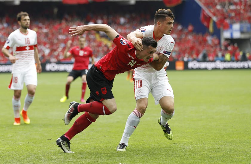 Switzerland's Granit Xhaka in action with Albania's Taulant Xhaka in the Group A match of Euro 2016 in Lens, France on Saturday, June 11, 2016. Photo: Reuters