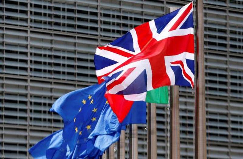 British flag and European Union flags flutter outside the EU Commission headquarters in Brussels, Belgium, June 28, 2016. Photo: Reuters