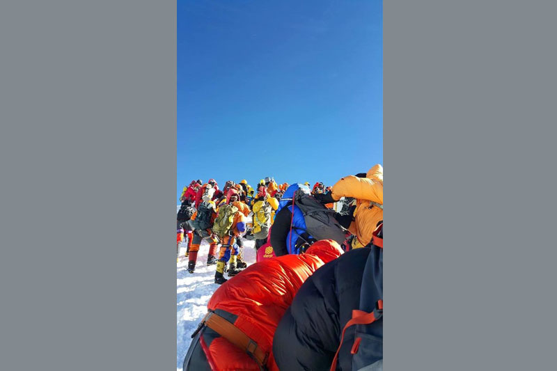 Climbers on top of Everest on May 20, 2016. Photo Credit: Garrett Madison