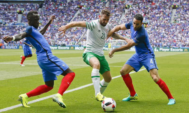 Ireland's Daryl Murphy, center, challenges for the ball with France's Eliaquim Mangala, left, and France's Adil Rami during the Euro 2016 round of 16 soccer match between France and Ireland, at the Grand Stade in Decines-?Charpieu, near Lyon, France, Sunday, June 26, 2016. Photo: AP