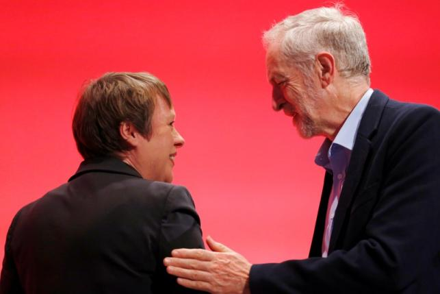 Britain's opposition Leader of the Labour Party Jeremy Corbyn touches shadow defence secretary Angela Eagle as she leaves stage at the annual Labour Party Conference in Brighton, southern Britain 28 September, 2015.  REUTERS/Luke MacGregor