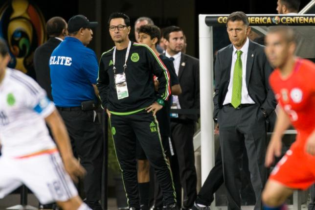 Mexico head coach Juan Carlos Osorio watches the game against Chile in the second half during quarterfinal play in the 2016 Copa America Centenario soccer tournament at Levi's Stadium. Chile won 7-0.  Mandatory Credit: John Hefti-USA TODAY Sports