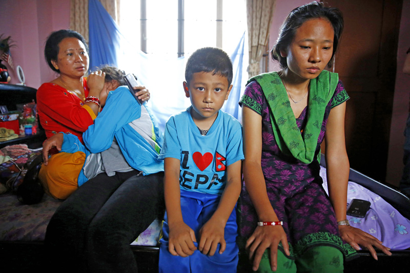 Sajani Thapa (left), niece of  Chandra Bahadur Rana Magar, who was killed in ansuicide attack in Kabul, consoling Magaru0092s daughter Astha at their residence in Kathmandu on Tuesday. Asthau0092s siblings, Anup and Ashmita, are also in this image. Photo: THT