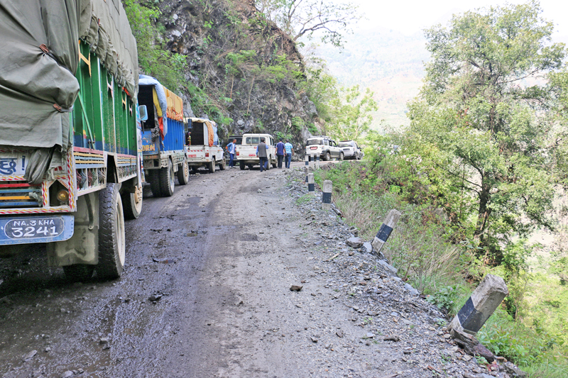 Vehicles stranded along the Karnali Highway as a landslide obstructs the road, on Friday, June 24, 2016. Photo: RSS