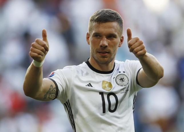 Football Soccer - Germany v Slovakia - EURO 2016 - Round of 16 - Stade Pierre-Mauroy, Lille, France - 26/6/16nGermany's Lukas Podolski celebrates at the end of the match nREUTERS/Lee SmithnLivepic
