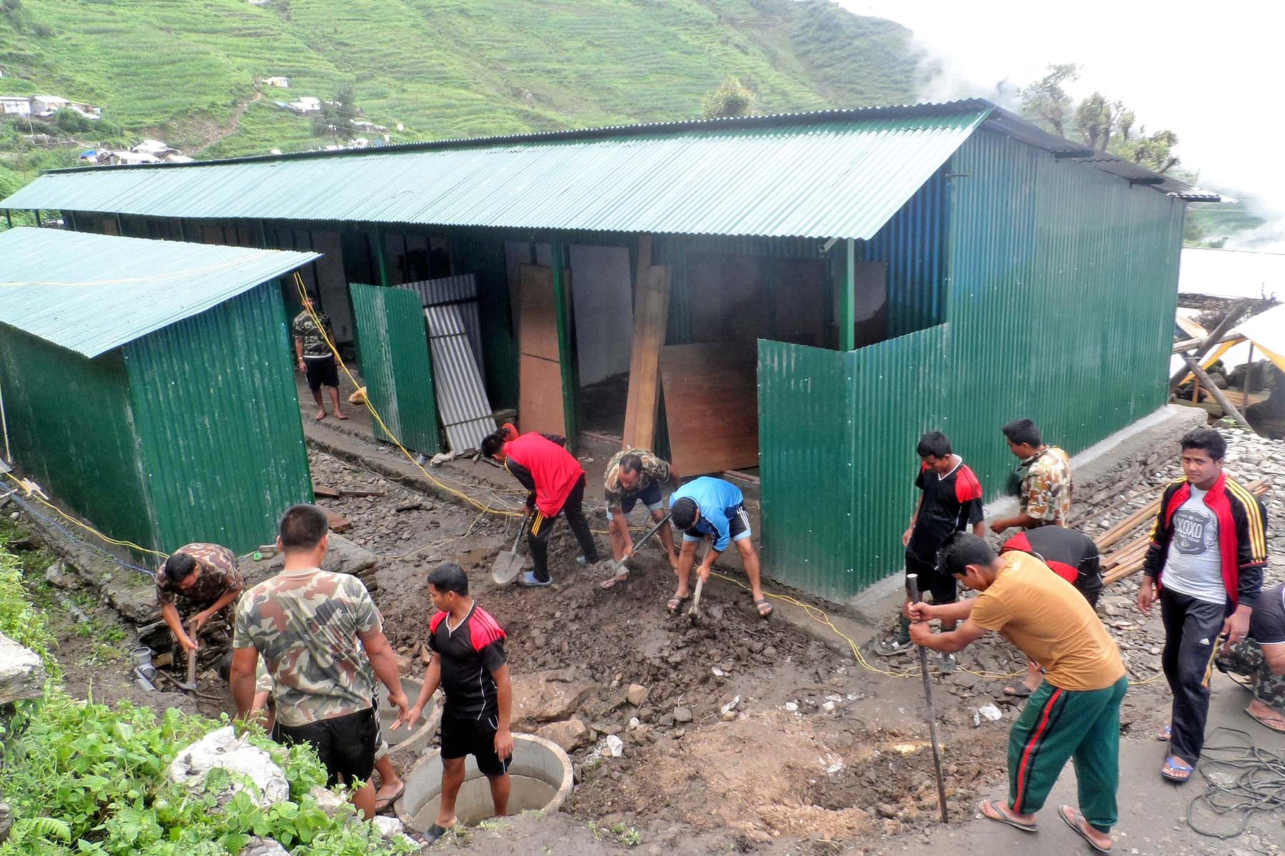 Personnel of the Nepal Army constructing an eight-room community shelters in Keraunja village of northern Gorkha, on Saturday, June 25, 2016. Photo: RSS