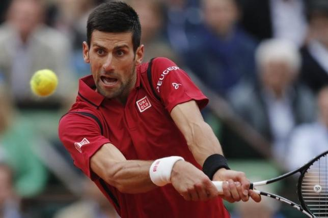 Tennis - French Open Men's Singles Final match - Roland Garros - Novak Djokovic of Serbia vs Andy Murray of Britain - Paris, France - 05/06/16. Novak Djokovic returns the ball. REUTERS/Benoit Tessier