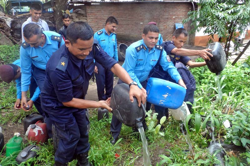 Police personnel destroy about 250 litres of hooch that they had confiscated from locals of Biren Chok in Gorakha district, on Monday, June 27, 2016. Photo: RSS