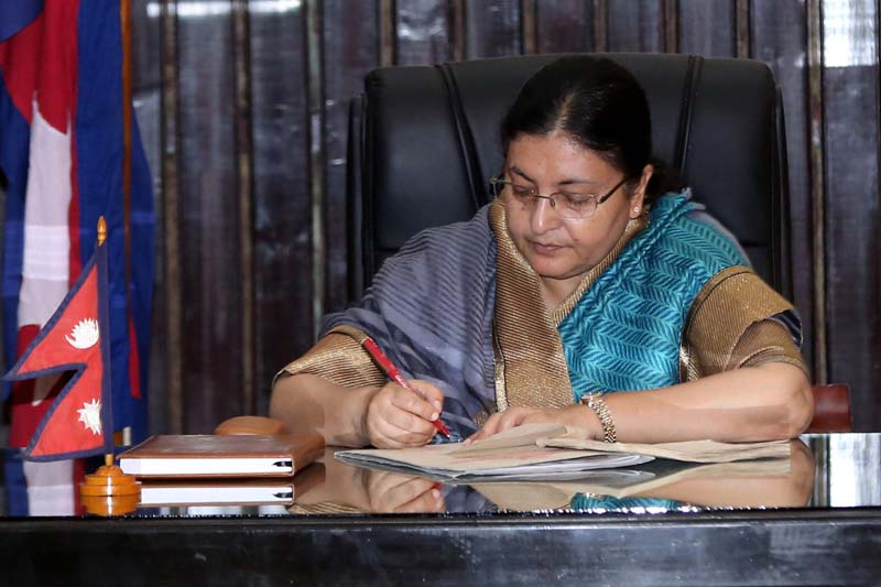 President Bidya Devi Bhandari certifies the Education Act Eighth Amendment Bill - endorsed by the Parliament on June 4 - at the President's Office, in Sheetal Niwas, on Wednesday, June 29, 2016. Photo: RSS
