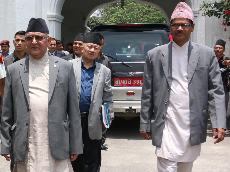 Prime Minister KP Sharma Oli and Acting Chief Election Commissioner Ayodhi Prasad Yadav (right) emerge from a meeting at the Election Commission on Monday, June 27, 2016. Photo: RSS