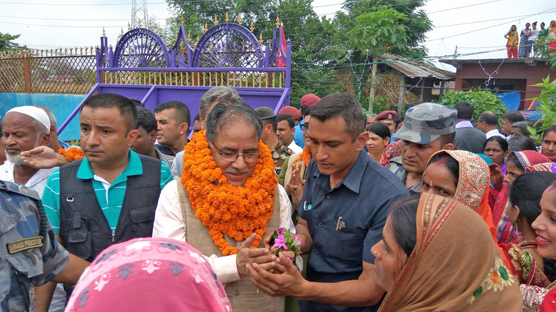 CPN Maoist Centre Chairman Puspa Kamal Dahal being welcomed at Rautahat on Monday, June 27, 2016. Dahal came to the district to attend the marriage ceremony of lawmaker Satya Nanda Bhagat's daughter. Photo: Prabat Kumar Jha