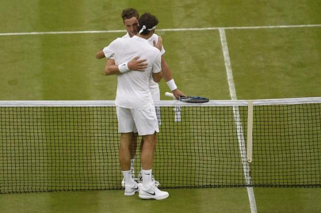 Britain Tennis - Wimbledon - All England Lawn Tennis & Croquet Club, Wimbledon, England - 29/6/16 Switzerland's Roger Federer with Great Britain's Marcus Willis after winning their match REUTERS/Toby Melville