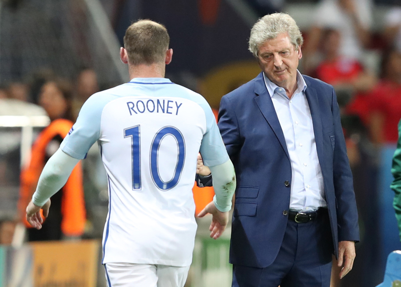 England coach Roy Hodgson salutes Wayne Rooney as he leaves the pitch to be replaced during the Euro 2016 round of 16 soccer match between England and Iceland, at the Allianz Riviera stadium in Nice, France, Monday, June 27, 2016. Photo: AP