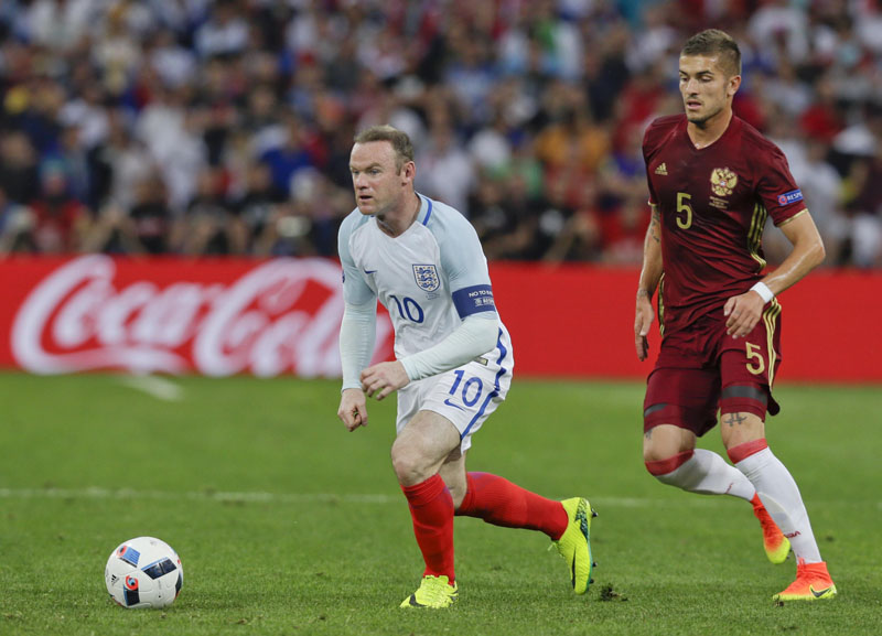 England's Wayne Rooney gets the ball past Russia's Roman Neustadter during the Euro 2016 Group B soccer match between England and Russia, at the Velodrome stadium, in Marseille, France, on Saturday, June 11, 2016. Photo: AP