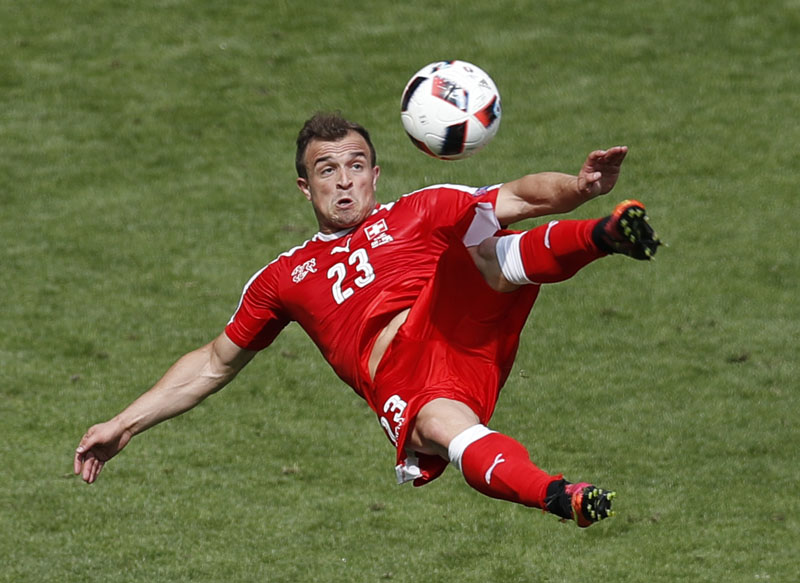 Switzerland's Xherdan Shaqiri scores on an acrobatic kick during the Euro 2016 round of 16 soccer match between Switzerland and Poland, at the Geoffroy Guichard stadium in Saint-Etienne, France, on Saturday, June 25, 2016. Photo: AP