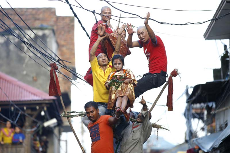 Children maintain balance on the tip of a prong implanted in a chariot procession to commemorate the Trishul Jatra festival at Jayabageshwori in Kathmandu, on Tuesday, June 28, 2016. Photo: Skanda Gautam l