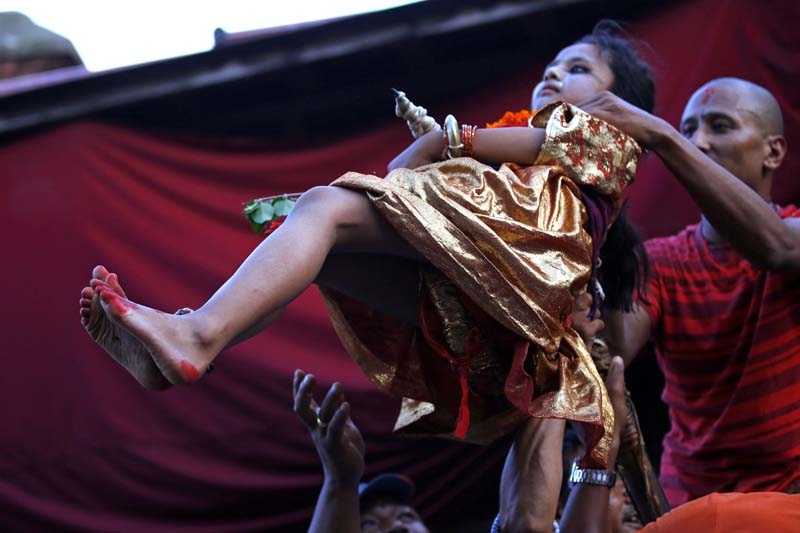 A child maintains balance on the tip of a prong implanted in a chariot procession to commemorate the Trishul Jatra festival at Jayabageshwori in Kathmandu, on Tuesday, June 28, 2016. Photo: Skanda Gautam