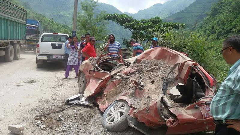 A car damaged by a landslide in Panch Kilo of Chandibhanjyang VDC along the Narayangadh-Muglin road section on Monday, June 27, 2016. Photo: Tilak Rimal