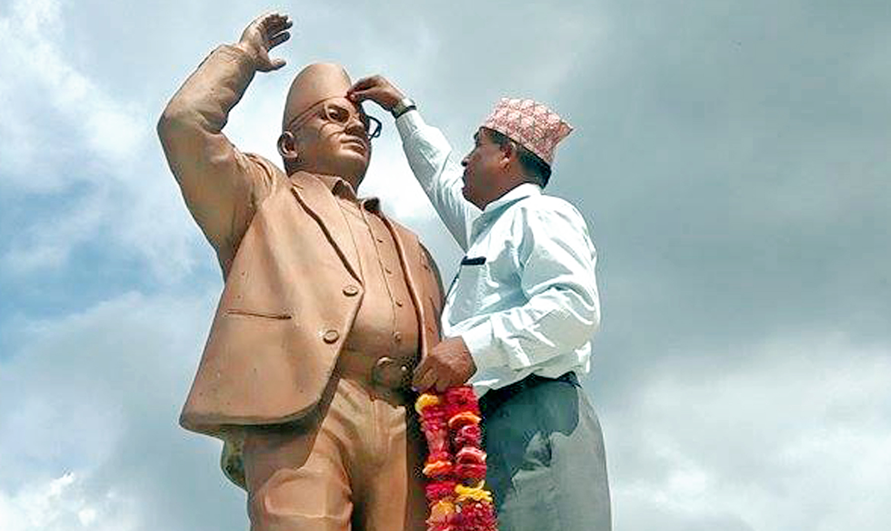 A man puts Tika and Wrath at the Statue of CPN-UML leader Madan Bhandari on the occasion of 65th birth anniversary in Urlabari, Morang district, on Tuesday, June 28, 2016. Photo: RSS