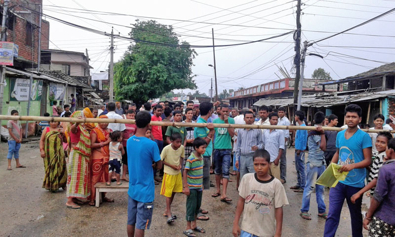 Flood victims obstruct the Rajbiraj-Hanumannagar road section demanding the authority look into their concerns on Friday, June 24, 2016. As many as 60 houses in Saptari have been inundated due to heavy rainfall. Photo: Byas Shankar Upadhyaya
