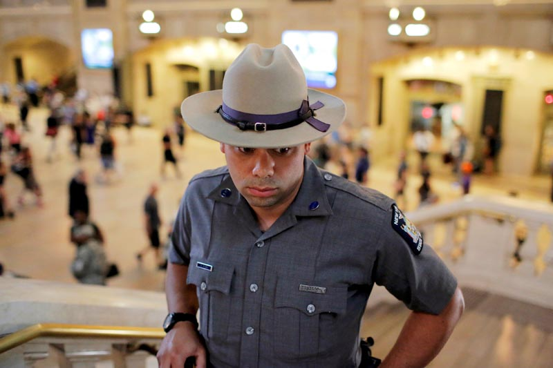 A member of the New York State Police monitors commuters at Grand Central Station as security increases leading up to the Fourth of July weekend in Manhattan, New York, U.S., July 1, 2016. Picture taken July 1, 2016. Photo: Reuters/File