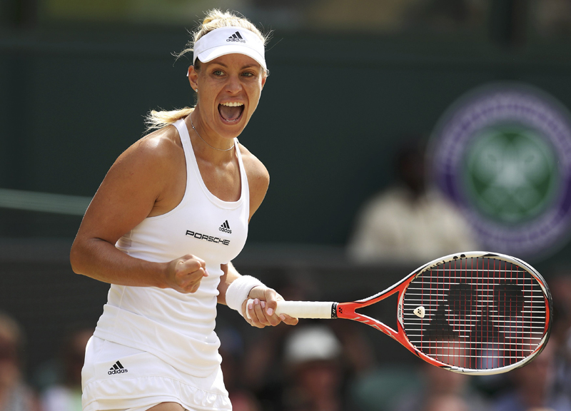 Germany's Angelique Kerber celebrates winning the first set in her match against USA's Venus Williams. Photo: Reuters