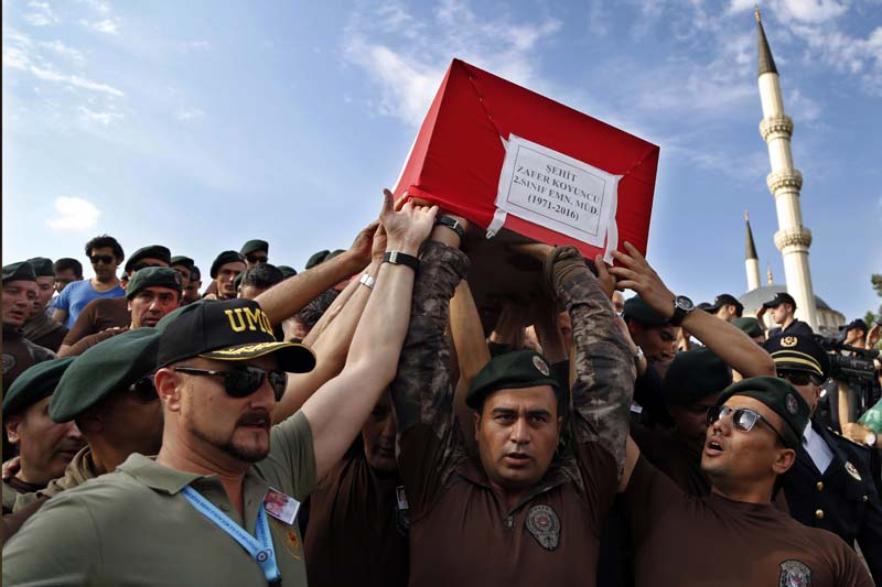 Turkish special forces policemen carry the coffin an officer who was killed last Friday during the failed military coup, during his funeral procession in Ankara, Turkey on Wednesday, July 20, 2016. Photo: AP