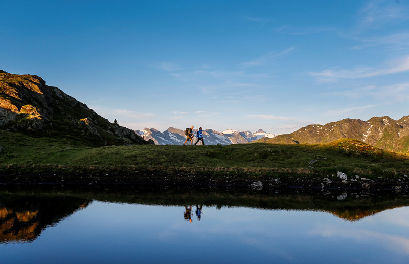A couple hikes during sunrise on Kreuzjoch mountain in the Zillertal Alps in Schwendau in Austria on July 11, 2016. Photo: REUTERS