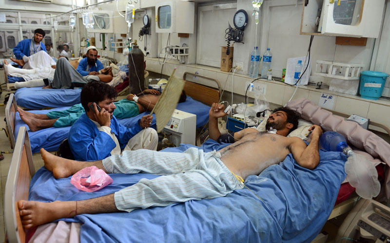 Wounded men lie on beds in a hospital after a suicide attack targeted a local tribal elder in Jalalabad, capital of Nangarhar province, Afghanistan, on Saturday, July 2, 2016. Photo: AP