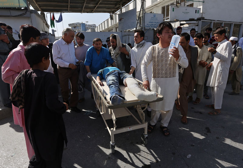 Afghans help an injured man at a hospital after an explosion struck a protest march, in Kabul, Afghanistan, on Saturday, July 23, 2016. Photo: AP