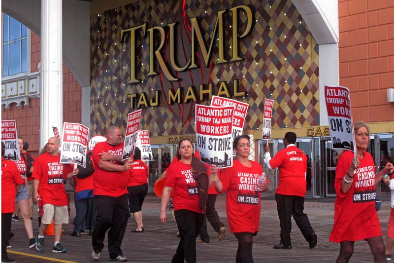 Striking union members walk a picket line outside the Trump Taj Mahal casino in Atlantic City, New Jersey, on Friday, July 1, 2016. Photo: AP