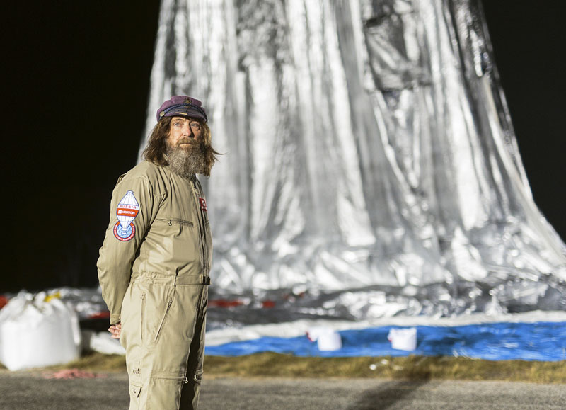 Morton, Russian adventurer Fedor Konyukhov stands by his helium and hot-air balloon being inflated before liftoff on his record attempt to fly solo in a balloon around the world nonstop in Northam in Western Australia state, on Monday, July 11, 2016. Photo: Oscar Konyukhov/Morton via AP