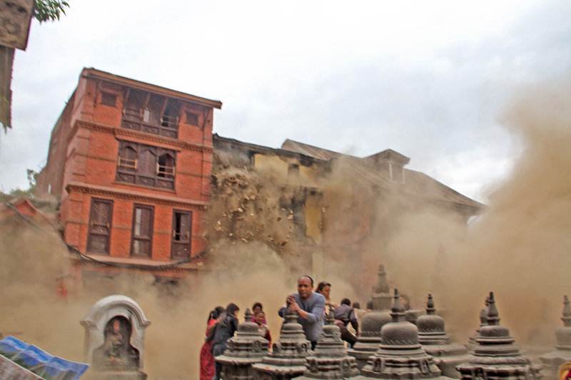 People trying to save themselves as dust engulfs a house in Swayambhu, after the  devastating earthquake, on Baisahak 12, 2015. Photo: Deepak Ratna Bajracharya