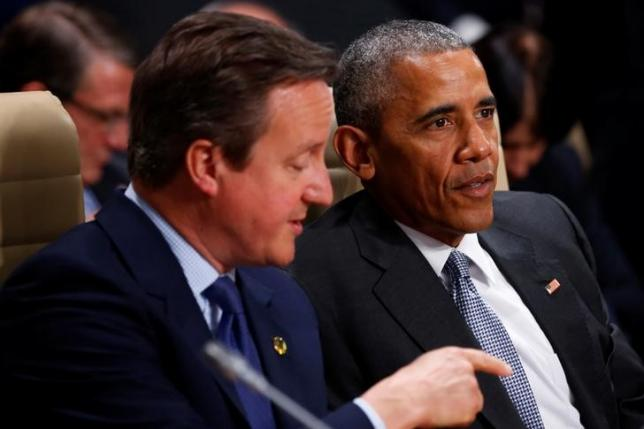 U.S. President Barack Obama and Britain's Prime Minister David Cameron participate in a working session of the North Atlantic Council at the NATO Summit in Warsaw, Poland July 9, 2016. REUTERS/Jonathan Ernst